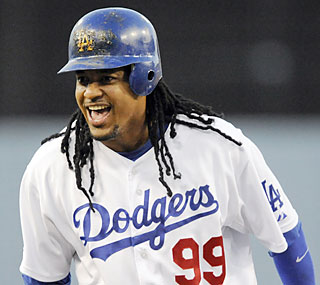 Manny Ramirez and the Dodgers take in the joy of both sweeping the D-Backs and tying a modern-day mark.  (AP)