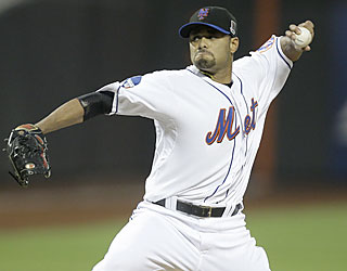 Johan Santana, who lowers his ERA to 0.91, continues to sizzle by baffling the Phillies through seven innings.  (AP)