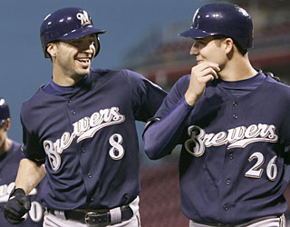 Ryan Braun provides a feel-good moment as he helps Manny Parra (26) earn his first win of the season.  (AP)
