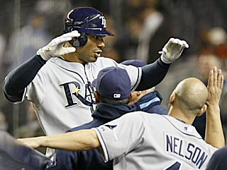 Carlos Pena enters a joyous Tampa Bay dugout after lining his MLB-leading 12th home run into the seats.  (AP)