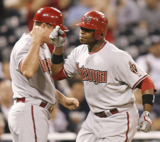 Justin Upton provides all the offense for the D-Backs by notching his first career multihomer game.  (AP)