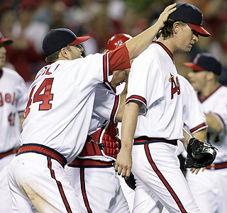 Mike Napoli gives Jered Weaver some love following Weaver's complete-game victory.  (AP)
