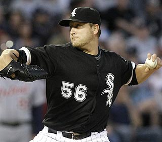 Mark Buehrle (5-0) retires the first 19 before Placido Polanco's double ends his bid for a perfect game. (AP)