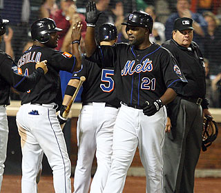 Here come the props for Carlos Delgado after his eighth-inning homer. He ends with five RBI. (Getty Images)