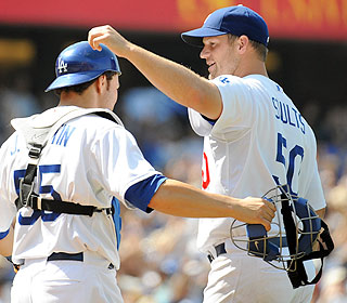 Eric Stults helps the Dodgers forget their troubles. He retires the first 13 batters he faces. (Getty Images)
