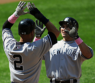 Derek Jeter thanks Johnny Damon for the outfielder's sixth homer in 10 games.  (US Presswire)