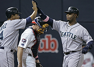 Ken Griffey Jr. receives props for his 614th homer, which ties the game in the eighth.  (AP)