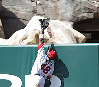 Torii Hunter is just about to rob Miguel Olivo from a game-tying homer in the ninth inning.  (AP)