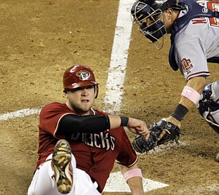 Chris Snyder beats the tag and the D-Backs beat the Nats for A.J. Hinch's first win as manager.  (AP)