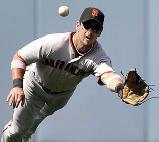 Aaron Rowand makes a few great defensive plays as the Giants win the series against their rivals.  (AP)