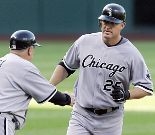 Jim Thome takes two trips around the bases and pushes his career homer total to 547. (AP)