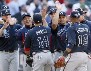 The Braves win thanks to Martin Prado, who comes up large with a go-ahead HR in the 12th.  (AP)