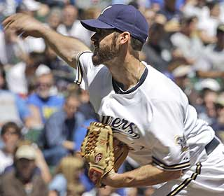 Dave Bush strikes out seven and allows two earned runs over seven innings for Milwaukee.  (AP)