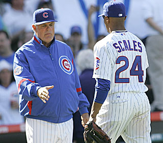 Lou Piniella thanks recent call-up Bobby Scales, who raps two two-run doubles in the win.  (US Presswire)