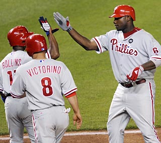 Ryan Howard (6) goes 1-for-6 but that one hit is a big one -- a three-run blast in the seventh.  (AP)
