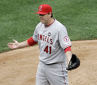 'What did I do?' John Lackey has the look of innocence on his face after being tossed in the first. (AP)