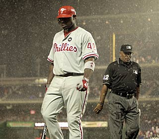 Ryan Howard and the Phillies get a little wet but the win should more than make up for it.  (AP)