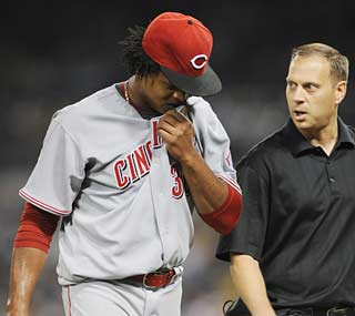 Mild back spasms force Reds starter Edinson Volquez out of the game in the sixth inning.  (US Presswire)
