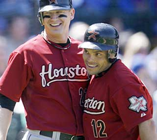 The Astros' Ivan Rodriguez (12) feels pretty good moments after he clubs his 300th home run.  (AP)