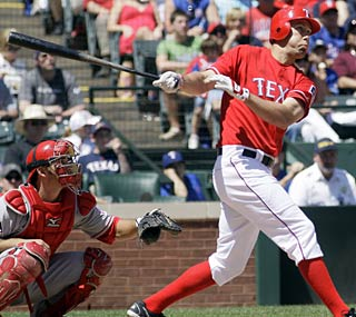 David Murphy puts the Rangers ahead with this sacrifice fly in the seventh.  (AP)