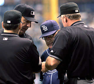 Oops! Joe Maddon's error forces pitcher Andy Sonnanstine to bat third in place of Evan Longoria.  (AP)