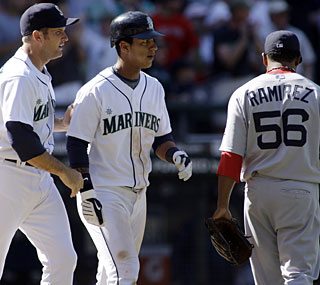 The Mariners take advantage of a Boston error to hand Ramon Ramirez the loss in the ninth.  (AP)