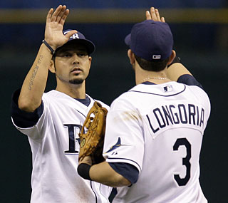 Jason Bartlett totals a career-high five RBI as the Rays win their fourth in a row.  (AP)
