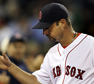 Tim Wakefield, with his knuckleball working well, records 16 of his 24 outs on fly balls.  (AP)
