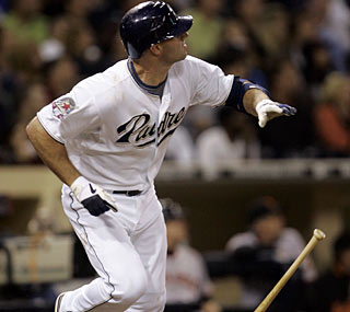 San Diego's Kevin Kouzmanoff flips the bat after he hits the decisive home run in the fourth.  (AP)