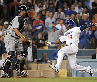 Orlando Hudson hustles to beat the throw at the plate and slides in for the winning run. (Getty Images)