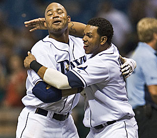 Carl Crawford (left) celebrates with Willy Aybar after capping the come-from-behind, walk-off victory.  (AP)