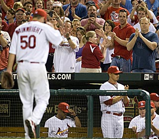 The home crowd appreciates Adam Wainwright's five-hit, one-run outing over 8 2/3 innings.  (US Presswire)