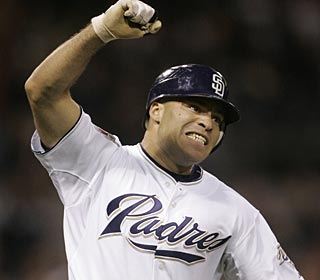 Scott Hairston pumps his arm in delight after he delivers the winning hit in the Padres' sixth consecutive win. (AP)