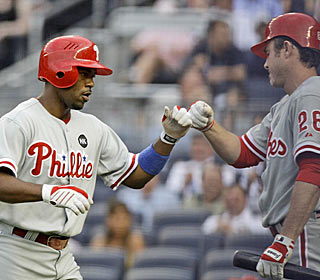 Jimmy Rollins gets the Phils right off the bat, crushing the first pitch of the game for a homer.  (AP)