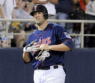 Michael Cuddyer settles into third base to complete the 10th cycle in Twins' history.  (AP)