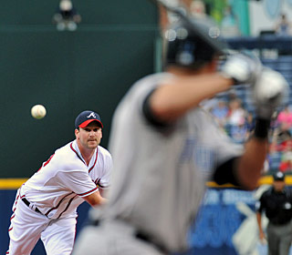 Derek Lowe gets it done on the mound as well as helping his cause with the bat. (AP)
