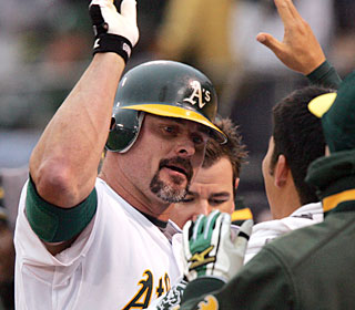 Jason Giambi drives the ball out of the park for the 400th time in his career. (US Presswire)