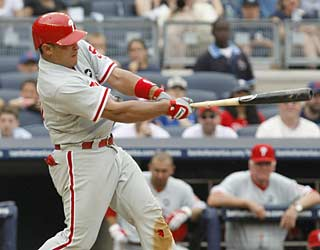 Carlos Ruiz delivers in the 11th to help the Phillies overcome another blown save by Brad Lidge.  (AP)