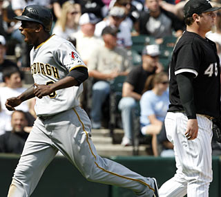 The Pirates' Nyjer Morgan races home with the winning run, saddling Bobby Jenks with the loss.  (AP)