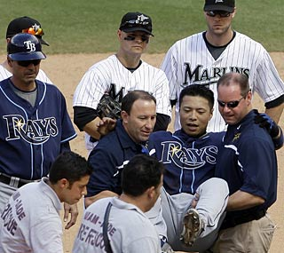 The Rays not only lose the game but Akinori Iwamura as well, who hurts his knee in the 8th.  (AP)