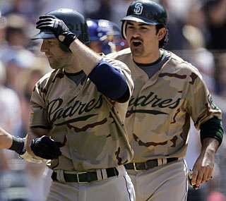 Kevin Kouzmanoff (left) collects four RBI to spark the Padres to their ninth consecutive win.  (AP)
