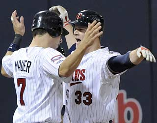 Joe Mauer and Justin Morneau combine for five RBI as the Twins complete the series sweep.  (AP)