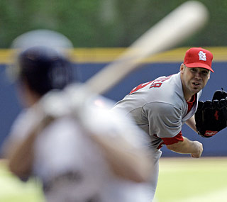 Milwaukee's Craig Counsell breaks up Chris Carpenter's bid for perfect game in the seventh.  (AP)