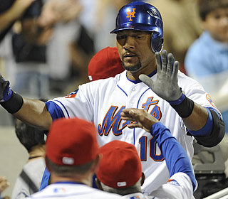 High-fives await Gary Sheffield in the Mets dugout following his tiebreaking three-run blast.  (AP)