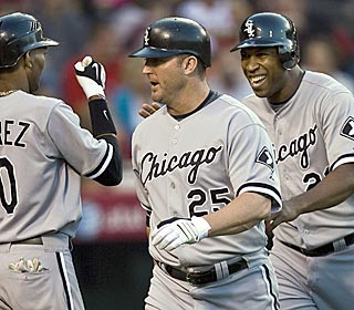 Jim Thome, middle, gets some well-earned props after clubbing a 3-run HR to move into 13th place.  (AP)