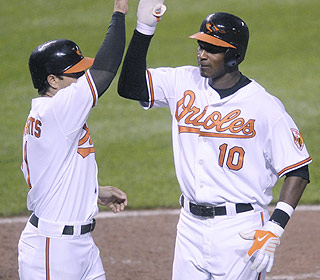 Adam Jones (right) keeps his breakout campaign rolling. He hits his 11th homer in the fifth inning. (AP)