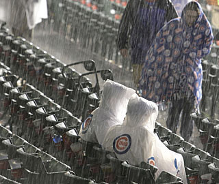 Chicago fans brush off the bad weather to watch their Cubs finally get back in the win column.  (AP)