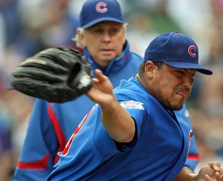 Carlos Zambrano throws 112 pitches and one glove in 6 1/3 innings of work vs. the Pirates.  (Getty Images)