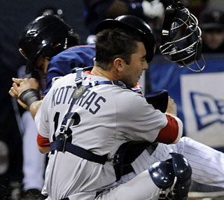 Boston's George Kottaras has a long night at the plate catching a wild Red Sox pitching staff.  (AP)