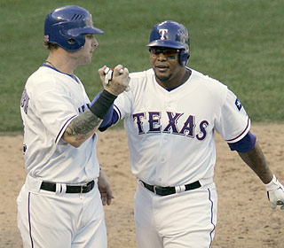 Andruw Jones (right) comes through in the eighth inning with a two-run jack off Santiago Casilla. (AP)
